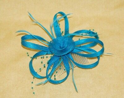 Elegant Dark Turquoise Sinamay, Feathers & Beads Fascinator on Comb.