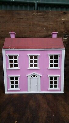 wooden dolls house with miniature furniture