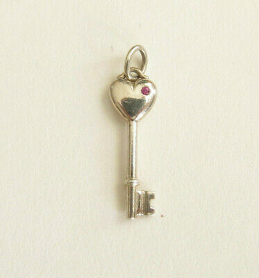 AUTH. TIFFANY & Co STERLING SILVER AND PINK SAPPHIRE HEART KEY CHARM PENDANT