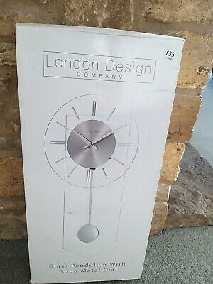 Modern Chrome & Glass Wall Clock with Pendulum. New. Been in storage
