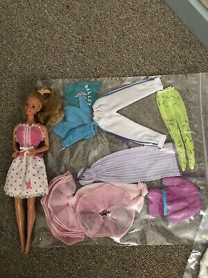Vintage Ballerina barbie and outfits.