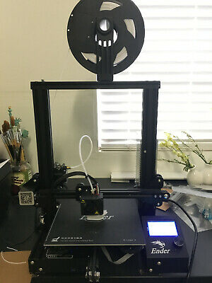 Creality Ender 3 3D printer w/ white, blue, and wood filament included.
