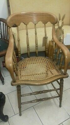 Antique light  Oak Armchair spindle back and sides.unique looking chair