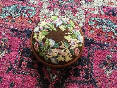 Small vintage round wood veneer footstool, padded wool work tapestry top