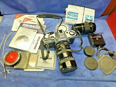 Canon AE-1 35mm Camera 2 Lenses Manual Books Filters remote