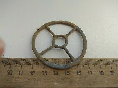 of ancient bronze  amulet - a solar circle,