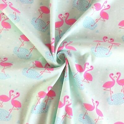 100% cotton Interlock knit jersey baby fabric, pink flamingos on blue background