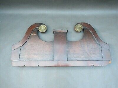 Part of an antique wooden clock pediment with brass roundels - spares or parts