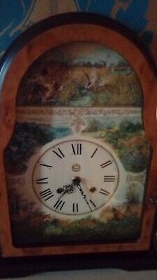 Ornate mantle clock country scenes