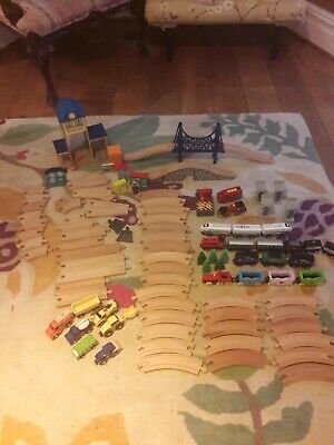 Wooden train track bundle, includes a remote controlled engine. Brio and others.