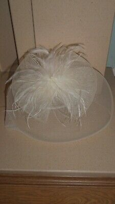 Cream fascinator with net bow and wispy feather-like tendrils (headband)
