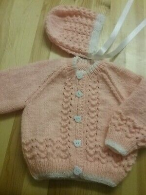 New hand knitted peach/ white baby cardigan & bonnet  0/3 mths