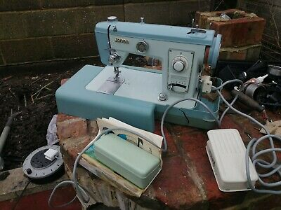 Jones Brother Electric Sewing Machine With Manuel & Attachments