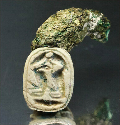 Egyptian scarab with remnants of original bronze ring. 1650 B.C,