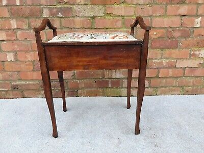 Antique piano stool with tapestry seat pad