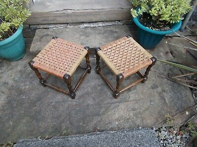 A pair of vintage/antique barley twist woven wicker/Rattan foot stools