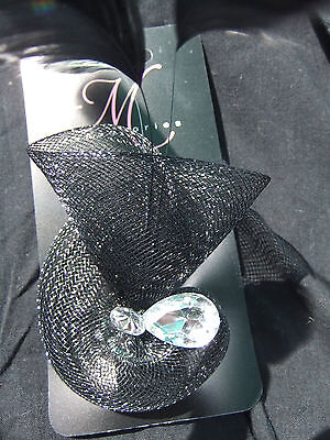 Small black fasinator/brooch with sequin and feather new