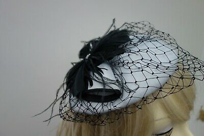 Grey & Black with feathers & sparkle fascinator /hat with elastic preowned vgc