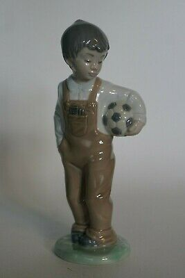 Lladro Nao - Figure of a Young Boy carrying a Football under his arm
