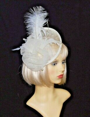 Elegant Cream Sinamay Disc Fascinator with Feather & Bow on Hair Clip.