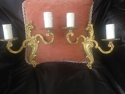 A pair of Vintage French Rococo gilt brass double sconce wall lights