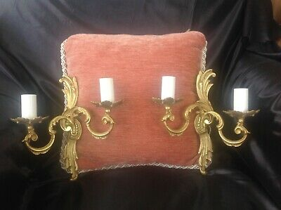 A pair of French Rococo gilt brass double sconce wall lights