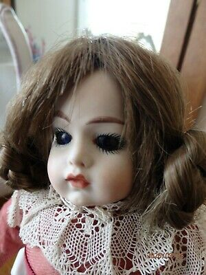 Antique reproduction of 11inch (28 cm) French Bru doll no makers mark solid body