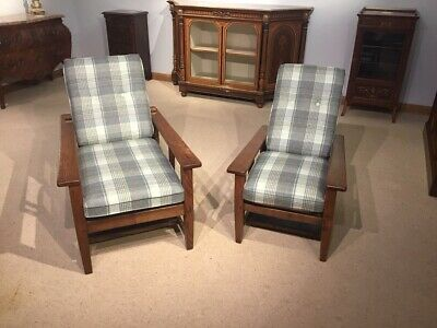 A Pair of oak Arts & Crafts Period gentlemen's and ladies accompanying reclining