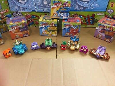Superzings Series 3, 4 Rare Metallic Sliders + 4 Random Super zings Figures.