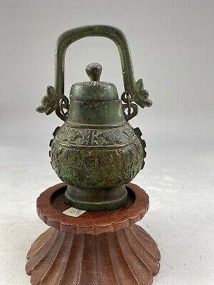A 19th Century Chinese Bronze With Lid And Handle