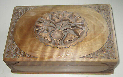 Antique intricately carved wooden box