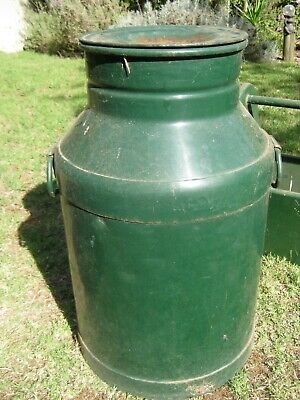 Vintage milk can, has lid in good painted condition pick up only.