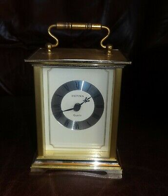 Carriage Clock in brass case 15cm (including handle) * 92mm*  67mm. AA Battery