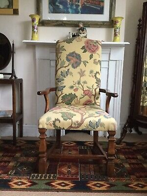 A FINE UPHOLSTERED OPEN ARMCHAIR IN CHESTNUT. LATE 17c REVIVAL.