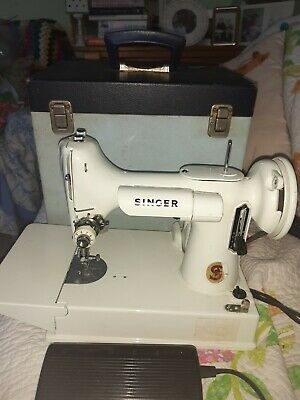 Singer 221 Featherweight Sewing Machine with case for spares or repairs.