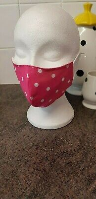 Brand new cotton face mask made from cerise pink polka dot fabric size lady teen