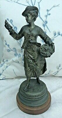 Antique Grey Metal Cast Alloy Figure of a Fruit Seller Lady on Wooden Plinth