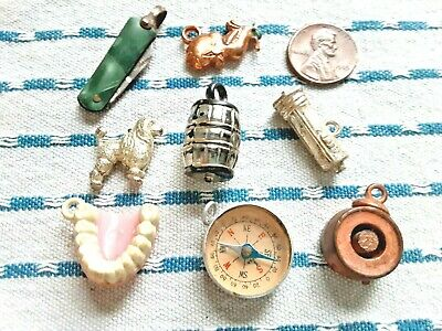 LOT OF 8 VINTAGE GUMBALL MACHINE CHARMS 1950s/60s: compass, teeth, knife, poodle