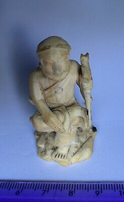 Carved Chinese figure of a western? man. Unusual style, great detail