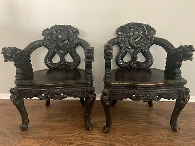 A pair of antique Wood Dragon Chairs