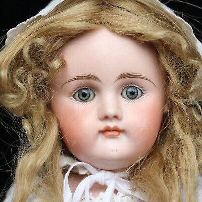 Antique Gottschalk Porcelain Doll with closed Mouth & Antique Doll´s pram