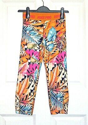 Nike Pro Dri Fit girl's sports leggings with orange &multi floral print12/13 yrs