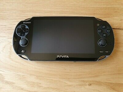 Sony PlayStation PS Vita Handheld System PCH1003 Wi-Fi, 16Gb card and 5 games
