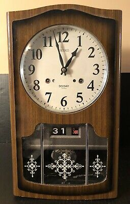 "Vintage Seiko 30 Day Key Wind Calendar (Day Date) Pendulum Wall Clock  17"" H"