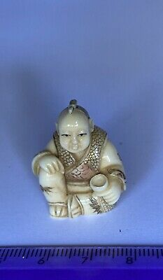 Japanese signed NETSUKE seated man with cup, beautiful detail