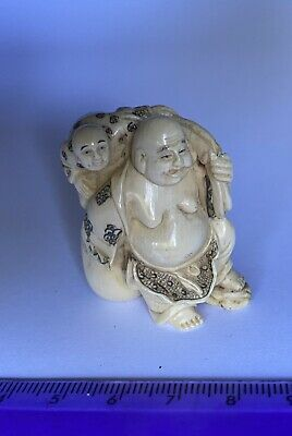 Japanese signed? NETSUKE man carrying a boy? beautiful expression and detail