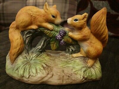 2 love Squirrel Figurines on log with berries