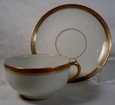 Limoges White and Gold Cup and Saucer