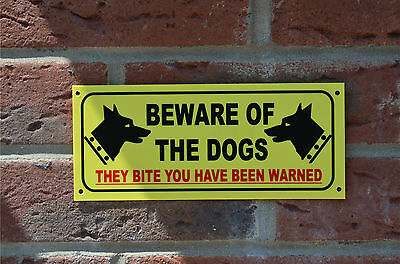 Beware of the dogs they bite you been warned warning house security wall sign