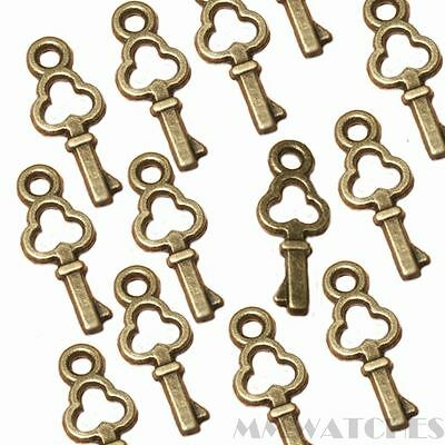 10 STEAMPUNK ANTIQUE GOLD ALICE STYLE KEY CHARM PENDANTS SIZE 15mmx9mm TS30